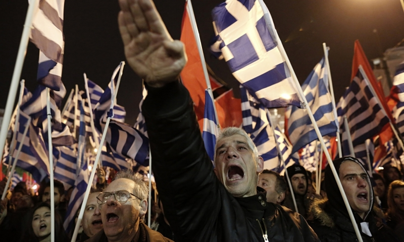A Golden Dawn supporter raises his hand in a Nazi salute during a rally in Athens. Photo: Yannis Kolesidis/AP (www.theguardian.com, 2.2.2014)