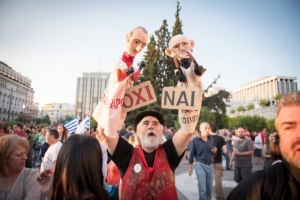 Athens, Greece. 3rd July 2015 -- A man holding two puppets with a yes and a no sign. Photo: Dimitris Parthimos/Demotix/Corbis