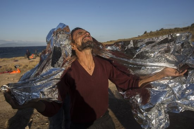 A man reacts after arriving on Lesbos, Greece, on Oct. 28, 2015. (Santi Palacios/Associated Press)