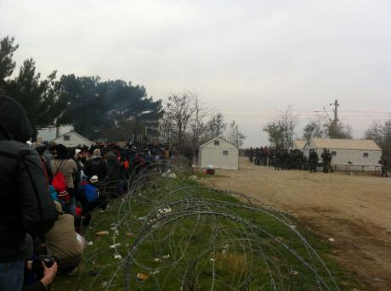 People queue on the left to try their luck crossing the guarded Greek-Macedonian border on 21 November. Source: Cameron Thibos.
