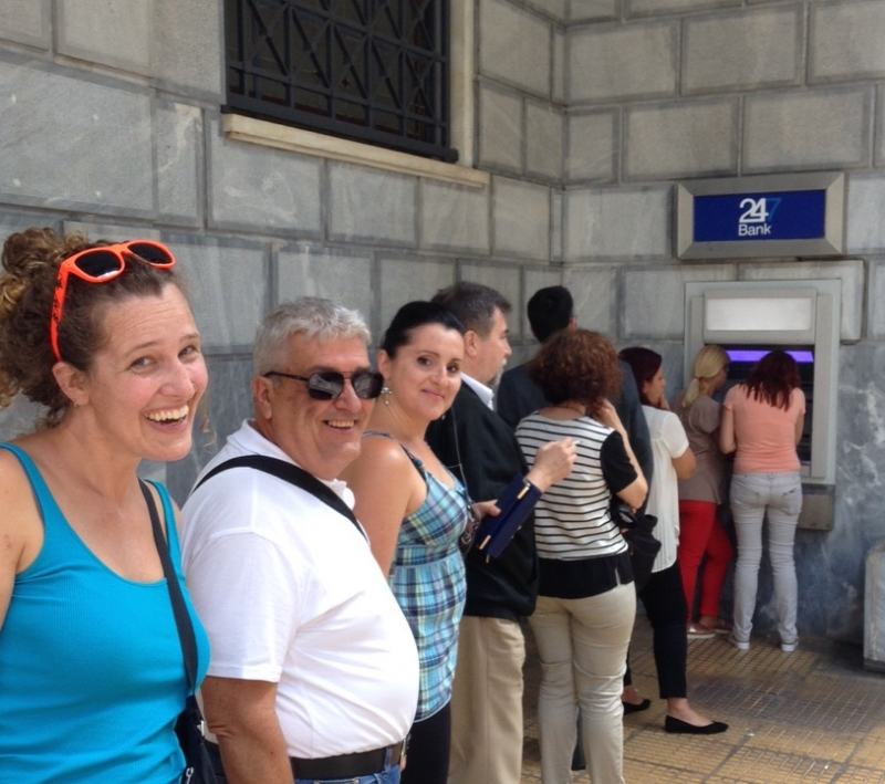 Athens, 1st of July, 2015. The surprisingly sociable line at the ΑΤΜ. The author is waiting in line to receive her 60 euros.