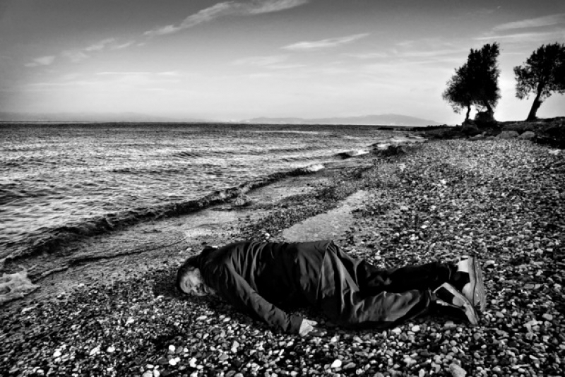 Chinese artist Ai Weiwei imitating the lifeless body of Syrian toddler Alan Kurdi on the Greek Island of Lesbos. (Rohit Chawla for India Today)
